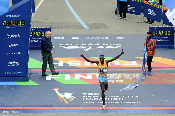 Stanley Biwott of Kenya crosses the finish line to win the Pro Men's division New York City Police Commissioner William J Bratton and Filmmaker and...