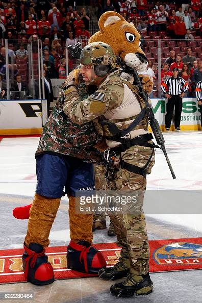 Stanley C Panther gives thanks to a Navy Seal that repealed from the catwalk in honor of Veterans Day prior to the start of the game between the...