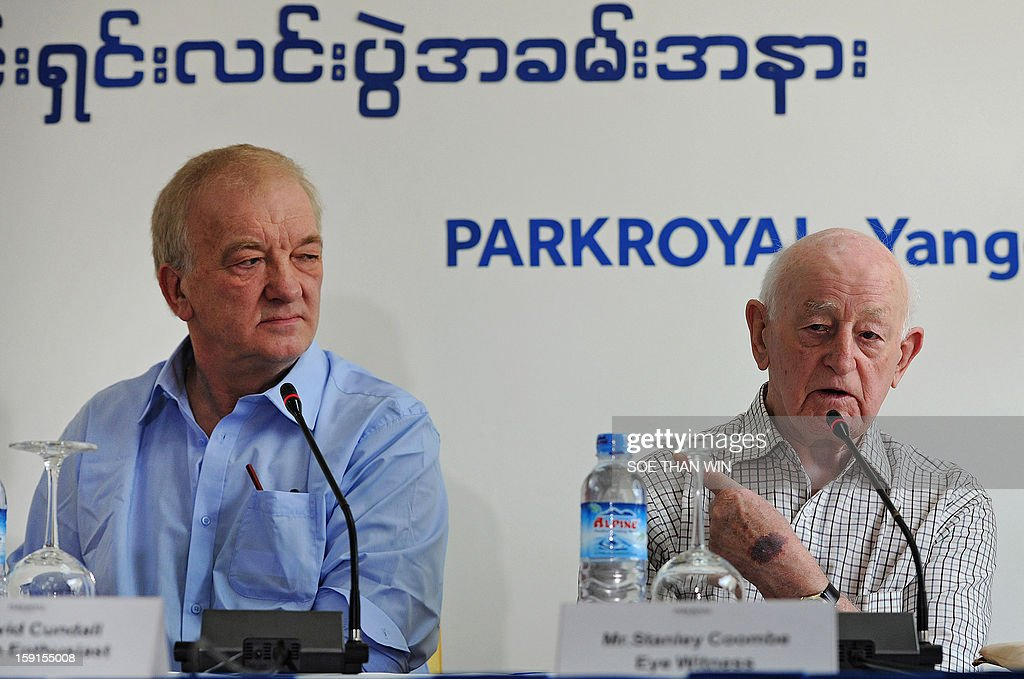 Stanley Coombe (R), a 91-year-old former British soldier who is one of eight people who said they have seen buried British Spitfires in Myanmar, speaks at a press conference as project leader David Cundall (L) looks on at a hotel in Yangon on January 9, 2013. A British-led excavation team hunting for dozens of rare Spitfires in Myanmar said during the press conference on January 9 they were confident of recovering the World War II-era planes after finding a crate buried in the ground. Britain is thought to have buried brand new planes in 1945 as they were surplus by the time they arrived by sea. AFP PHOTO / Soe Than WIN
