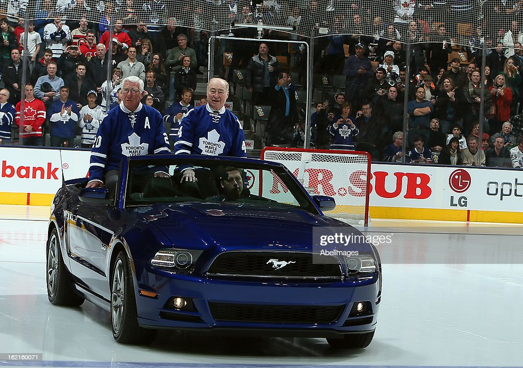 Stanley Cup Champions Bob Pulford and Red Kelly take to the ice during a ceremony commemorating the 50th anniversary of the team before NHL action at the Air Canada Centre February 16, 2013 in Toronto, Ontario, Canada.