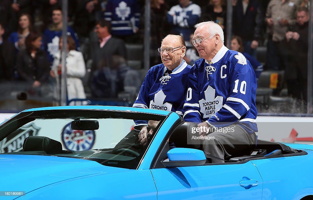 Stanley Cup Champions Johnny Bower and George Armstrong take to the ice during a ceremony commemorating the 50th anniversary of the team before NHL action at the Air Canada Centre February 16, 2013 in Toronto, Ontario, Canada.