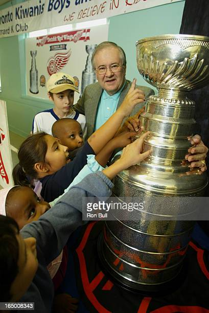 Stanley Cup RB02 10/19/02 Release in Photo layout desk Detroit Red wings Senior Vice President Jim Devellano brings Stanley Cup to Toronto Kiwanis...