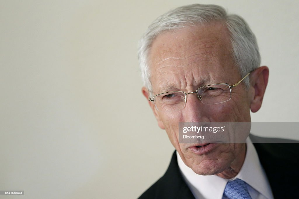 "<a gi-track='captionPersonalityLinkClicked' href=/galleries/search?phrase=Stanley+Fischer&family=editorial&specificpeople=233518 ng-click='$event.stopPropagation()'>Stanley Fischer</a>, governor of the Bank of Israel, poses for a photograph after an interview at the Annual Meetings of the International Monetary Fund (IMF) and the World Bank Group in Tokyo, Japan, on Saturday, Oct. 13, 2012. While there has been ""a lot of progress made"" to improve the global economy, its impact hasn't materialized, Fischer said. Photographer: Kiyoshi Ota/Bloomberg via Getty Images"