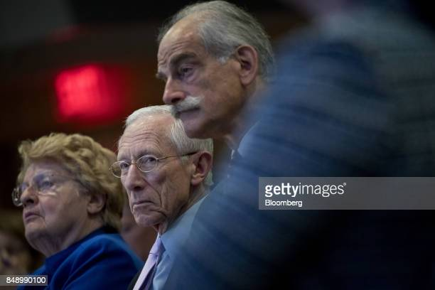 Stanley Fischer vice chairman of the US Federal Reserve center listens as Mark Carney governor of the Bank of England not pictured speaks during a...