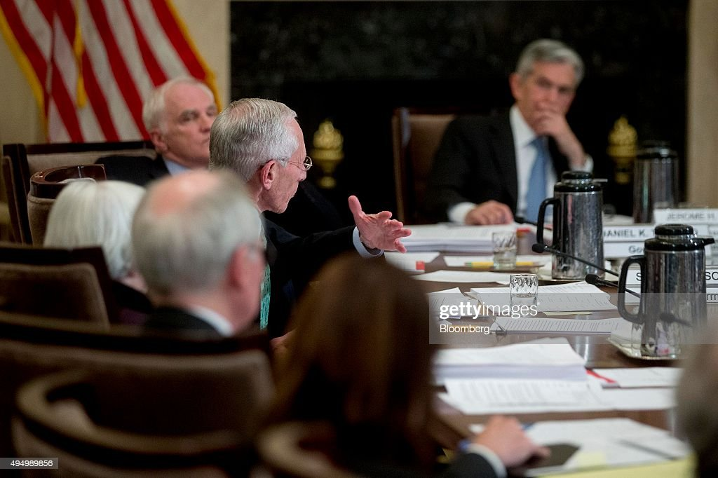 Stanley Fischer, vice chairman of the U.S. Federal Reserve, center, speaks during an open meeting of the Board of Governors of the Federal Reserve with Janet Yellen, chair of the U.S. Federal Reserve, left, and Jerome Powell, governor of the U.S. Federal Reserve, right, in Washington, D.C., U.S., on Friday, Oct. 30, 2015. According to a Federal Reserve rule that's set to be approved today, the largest U.S. banks would face a $120 billion total shortfall of long-term debt under a Fed proposal aimed at ensuring their failure wouldn't hurt the broader financial system. Photographer: Andrew Harrer/Bloomberg via Getty Images