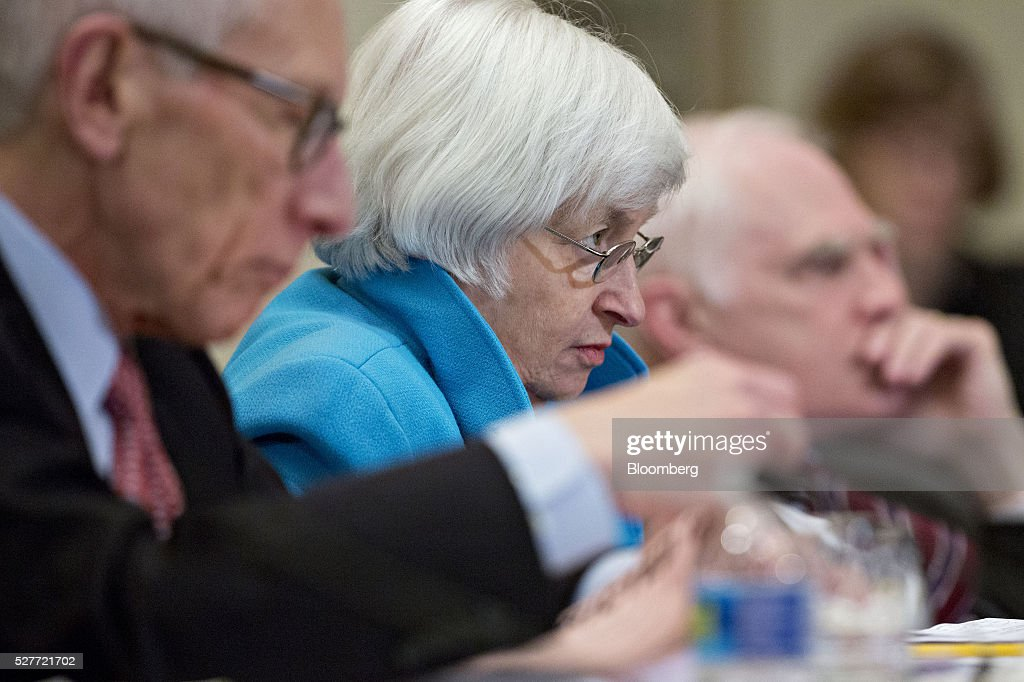 Stanley Fischer, vice chairman of the U.S. Federal Reserve, from left, Janet Yellen, chair of the U.S. Federal Reserve, and Daniel Tarullo, governor of the U.S. Federal Reserve, listen during a meeting of the Board of Governors of the Federal Reserve in Washington, D.C., U.S., on Tuesday, May 3, 2016. Hedge funds, insurers and other companies that do business with Wall Street megabanks are poised to pay a price for regulators' efforts to make sure any future collapse of a giant lender doesn't tank the entire financial system. Photographer: Andrew Harrer/Bloomberg via Getty Images