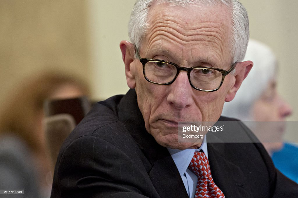 Stanley Fischer, vice chairman of the U.S. Federal Reserve, listens during a meeting of the Board of Governors of the Federal Reserve in Washington, D.C., U.S., on Tuesday, May 3, 2016. Hedge funds, insurers and other companies that do business with Wall Street megabanks are poised to pay a price for regulators' efforts to make sure any future collapse of a giant lender doesn't tank the entire financial system. Photographer: Andrew Harrer/Bloomberg via Getty Images