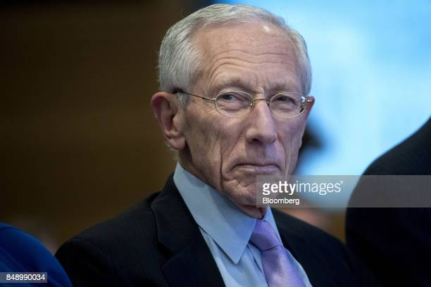 Stanley Fischer vice chairman of the US Federal Reserve waits for Mark Carney governor of the Bank of England not pictured to speak during a Michel...