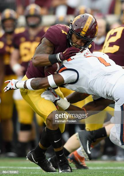 Stanley Green of the Illinois Fighting Illini tackles Rodney Smith of the Minnesota Golden Gophers during the second quarter of the game on October...
