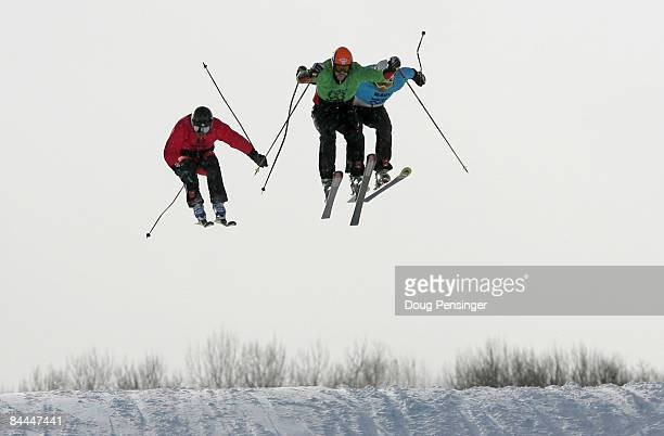 Stanley Hayer of Canada heads for the finish ahead of Hiroomi Takizawa of Japan in second and Andreas Steffen of Switzerland to win the finals and...