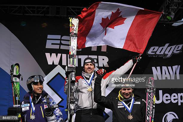 Stanley Hayer of Canada Hiroomi Takizawa of Japan and Andreas Steffen of Switzerland celebrate at the awards ceremony for the Men's Skier X Finals...