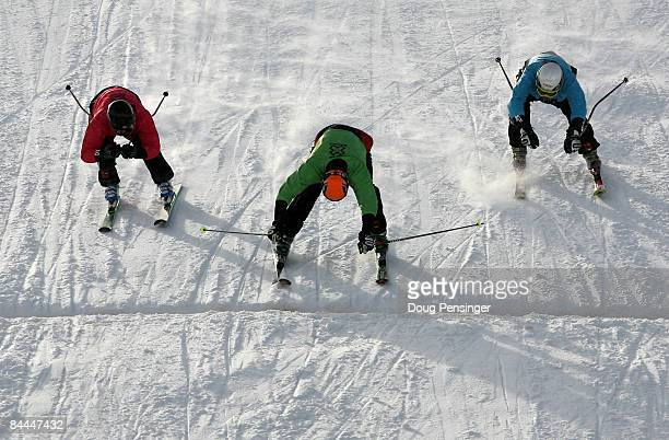 Stanley Hayer of Canada lunges for the finish line ahead of Hiroomi Takizawa of Japan in second and Andreas Steffen of Switzerland to win the finals...