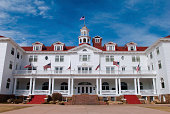 """""""Wide-angle view of the Stanley Hotel in Estes Park, Colorado with a rich blue sky in the background."""""""
