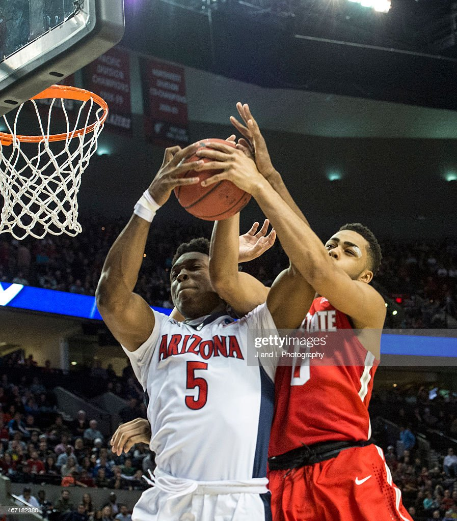 Stanley Johnson of the Arizona Wildcats fights for a loose ball against D'Angelo Russell of the Ohio State Buckeyes during the third round of the...