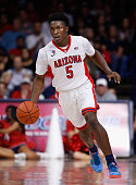 Stanley Johnson of the Arizona Wildcats handles the ball during the college basketball game against the Utah Valley Wolverines at McKale Center on...