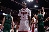Stanley Johnson of the Arizona Wildcats reacts after scoring against the Utah Valley Wolverines during the first half of the college basketball game...