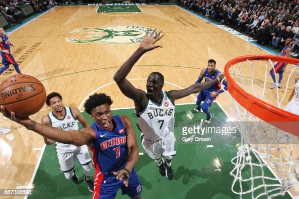 Stanley Johnson of the Detroit Pistons dunks against Thon Maker of the Milwaukee Bucks on December 6 2017 at the BMO Harris Bradley Center in...