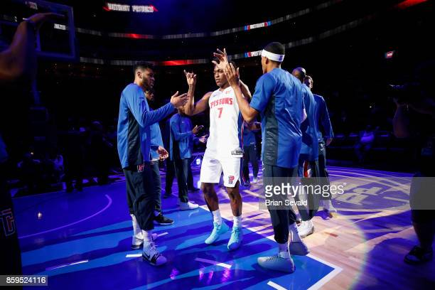 Stanley Johnson of the Detroit Pistons high fives his teammates before the game against the Indiana Pacers on October 9 2017 at Little Caesars Arena...