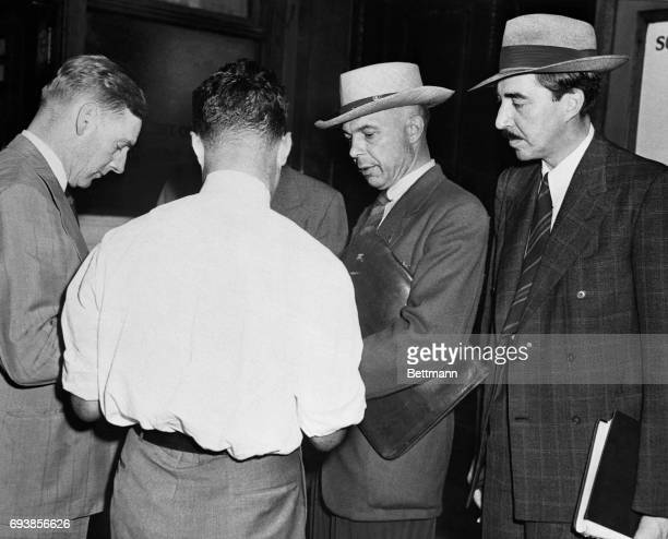 Stanley Johnston Chicago Tribune correspondent and JLoy Maloney managing editor of the paper are questioned by reporters after offering to appear...