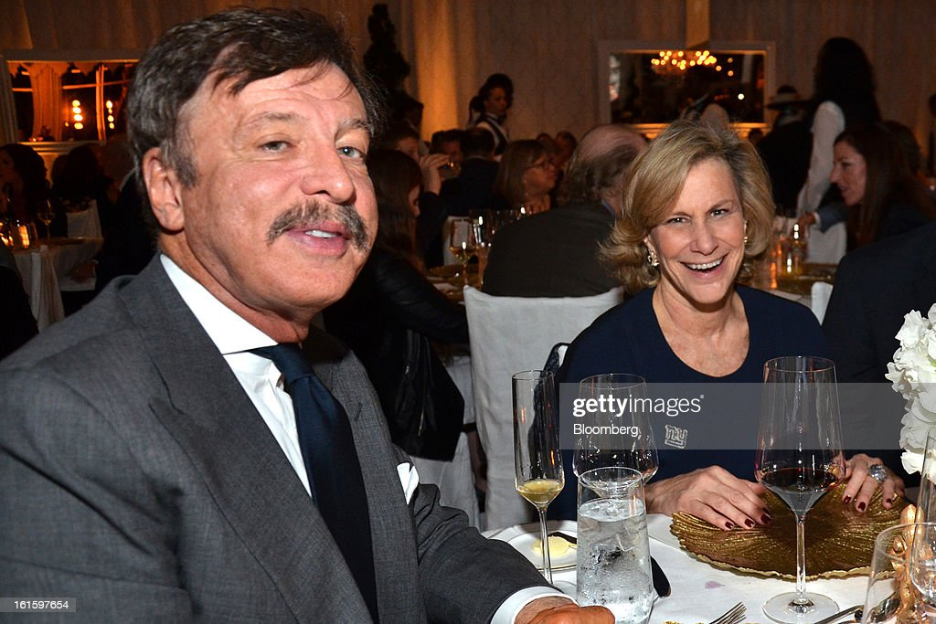 Stanley Kroenke, owner of the St. Louis Rams, and Laurie Tisch, an owner of the New York Giants, are seen during a party hosted by Tom and Gayle Benson, owners of the New Orleans Saints, for NFL team owners in New Orleans, Louisiana, U.S., on Thursday, Jan. 31, 2013. The party in City Park kicked off a weekend of festivities before Super Bowl XLVII. Photographer: Amanda Gordon/Bloomberg via Getty Images
