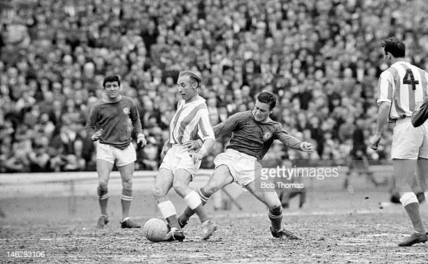 Stanley Matthews of Stoke City is tackled by Chelsea defender Ron Harris during their First Division match at Stamford Bridge in London 15th May 1963...