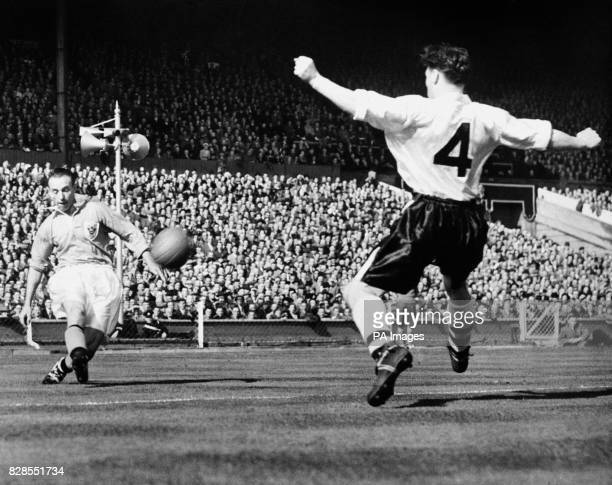Stanley Matthews streaks down the wing to beat Bolton right half J Wheeler and put across the centre from which South African Bill Perry scored the...