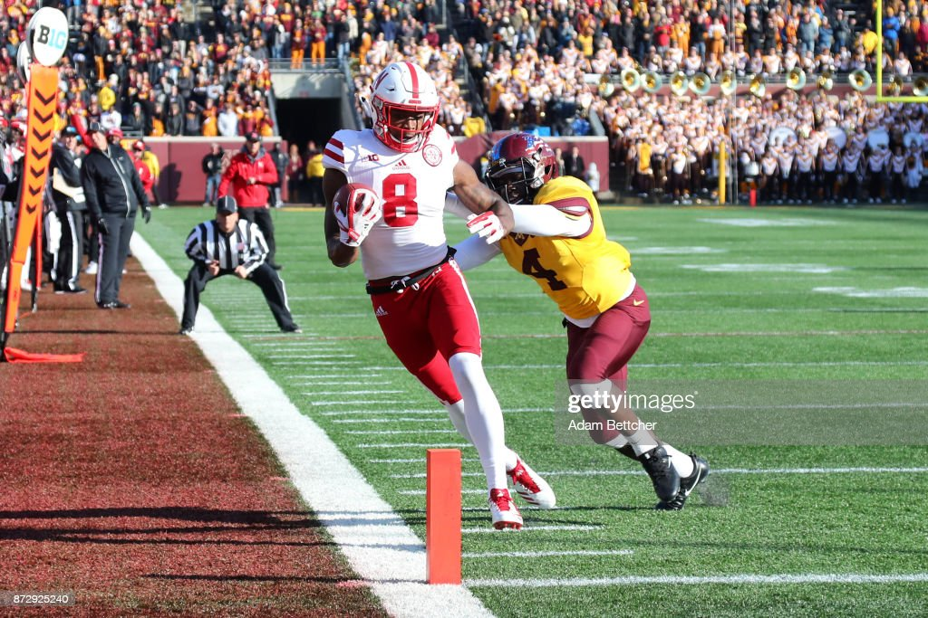 Stanley Morgan Jr. #8 of the Nebraska Cornhuskers pulls in a pass while Adekunle Ayinde #4 of the Minnesota Golden Gophers attempts the block in the fourth quarter against the Minnesota Golden Gophers at TCF Bank Stadium on November 11, 2017 in Minneapolis, Minnesota. Minnesota defeated Nebraska 54-21.