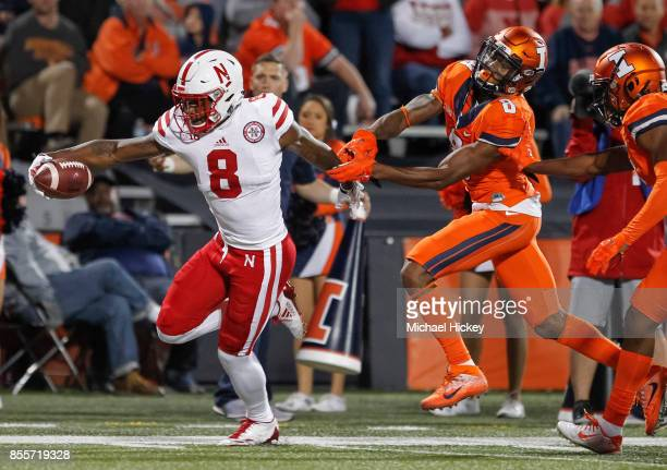 Stanley Morgan Jr #8 of the Nebraska Cornhuskers runs for the touchdown as Nate Hobbs of the Illinois Fighting Illini attempts the tackle at Memorial...