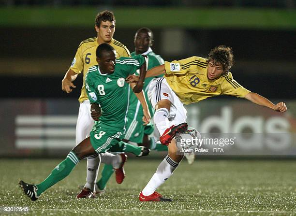 Stanley Okoro of Nigeria and Sergi Roberto of Spain compete for the ball during the FIFA U17 World Cup Semi Final match between Spain and Nigeria at...