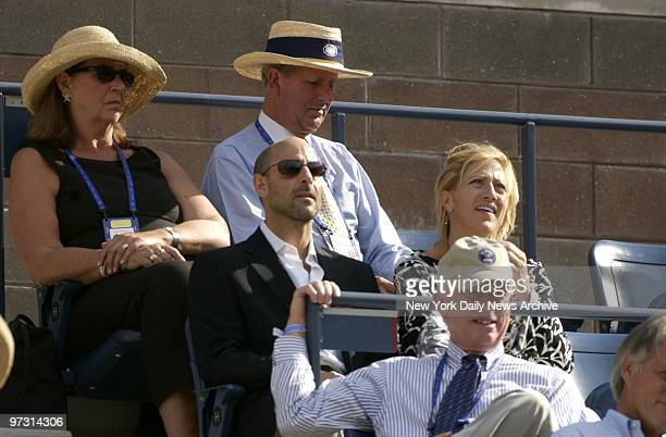 Stanley Tucci and Edie Falco are on hand for the men's final match between Andy Roddick of the US and Juan Carlos Ferrero of Spain at the US Open in...