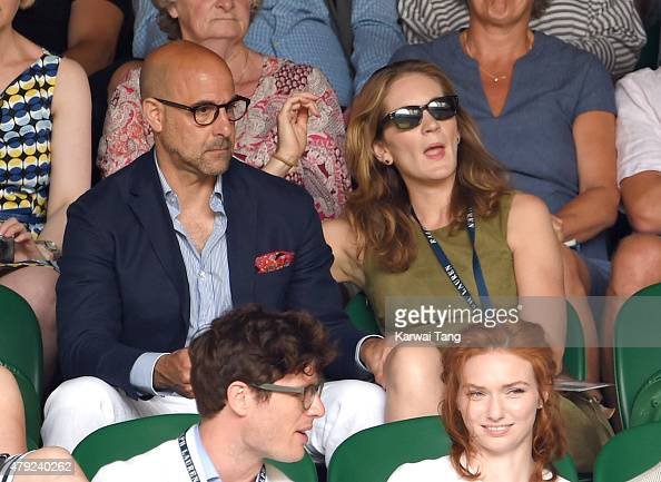 Stanley Tucci and Felicity Blunt attend the Sam Querry v Roger Federer match on day four of the Wimbledon Tennis Championships at Wimbledon on July 2...