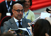 Stanley Tucci signs for the crowd at the premiere of 'Looking For Grace' during the 72nd Venice Film Festival on September 3 2015 in Venice Italy