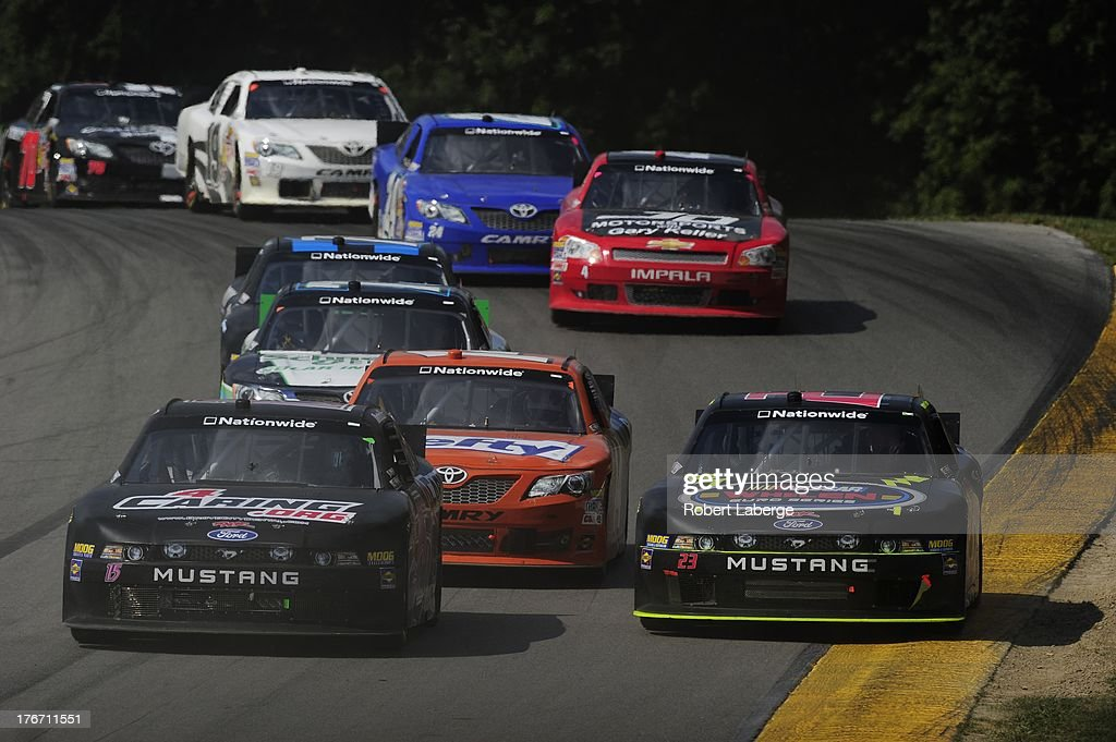 Stanton Barrett, driver of the #15 Rick Ware Racing Ford, leads a pack of cars during the NASCAR Nationwide Series Children's Hospital 200 at the Mid-Ohio Sports Car Course on August 17, 2013 in Lexington, Ohio.
