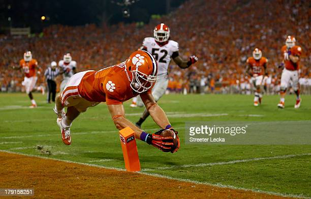Stanton Seckinger of the Clemson Tigers dives for a touchdown as Amarlo Herrera of the Georgia Bulldogs watches on during their game at Memorial...