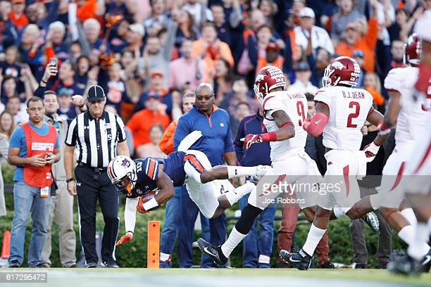 Stanton Truitt of the Auburn Tigers dives into the end zone for a 20yard touchdown as former Auburn and NFL great Bo Jackson watches in the first...