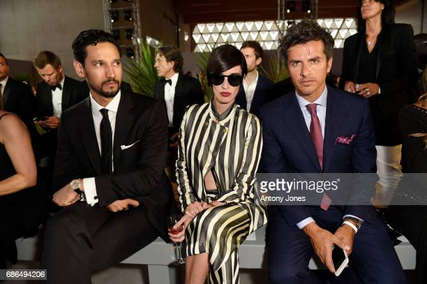 Stany Coppet Paz Vega and Orson Salazar attend the Fashion for Relief event during the 70th annual Cannes Film Festival at Aeroport Cannes Mandelieu...