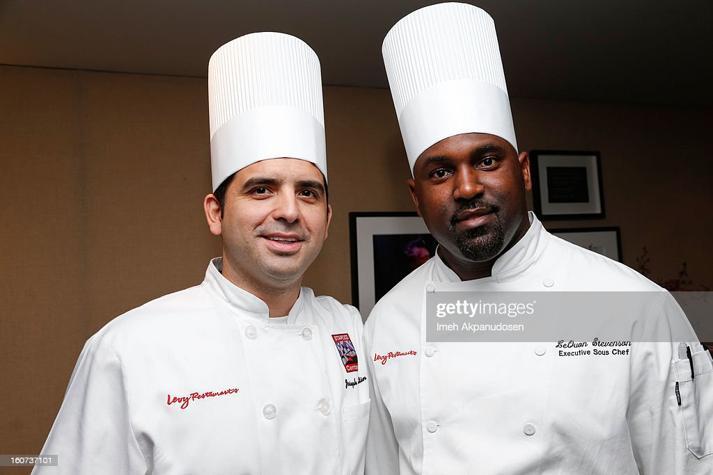 Staples Center Executive Chef Joseph Martin (L) and Executive Sous Chef LeQuon Stevenson attend a behind the scenes kitchen tour and suite menu tasting for the 55th Annual GRAMMY Awards at Staples Center on February 4, 2013 in Los Angeles, California.