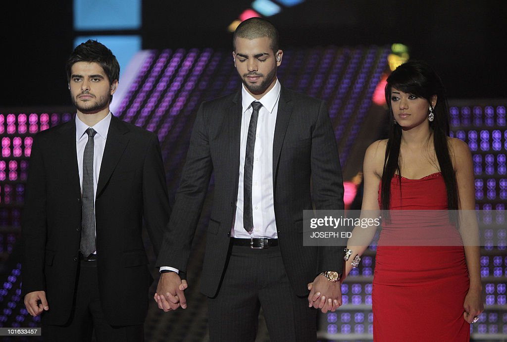 Star Academy's Nassif al-Zeitoun of Syria, Mohammed Ramdan of Jordan and Rahma al-Sibahi of Iraq wait for the final results of the highly successful pan-Arab television show, produced by Lebanese Broadcasting Corporation International (LBCI), at its studios in Adma, north of Beirut, late on June 4, 2010.