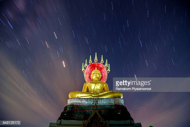 Star and gold Buddha statue, temple name is Wat Nang Lao in Songkhla, Thailand.
