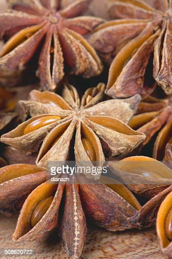 star anise on wooden surface : Stock Photo