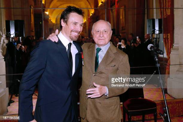 Star Dancer Nicolas le Riche receives the Insignia of Officer of the Legion of Honour from Pierre Berge at Opera Garnier on November 6 2013 in Paris...
