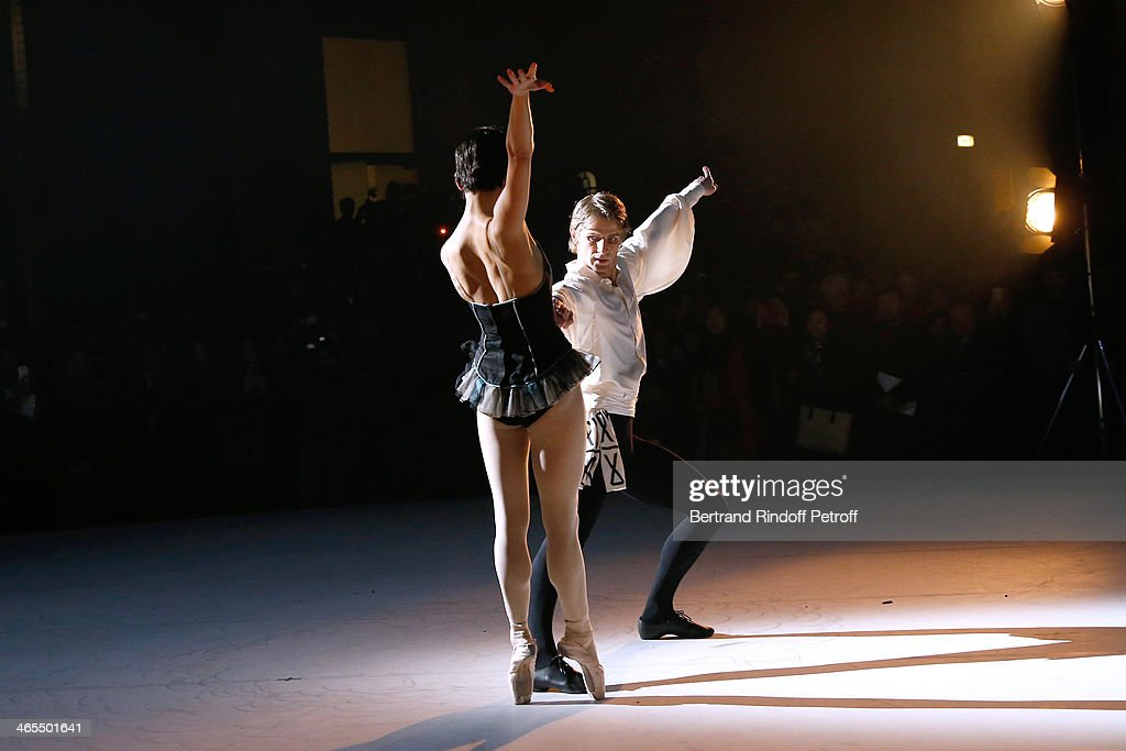 Star Dancers Zhang Jian (in black) and Karl Paquette (in white) perform at the 'Nuit De La Chine' - Opening Night at Grand Palais on January 27, 2014 in Paris, France.
