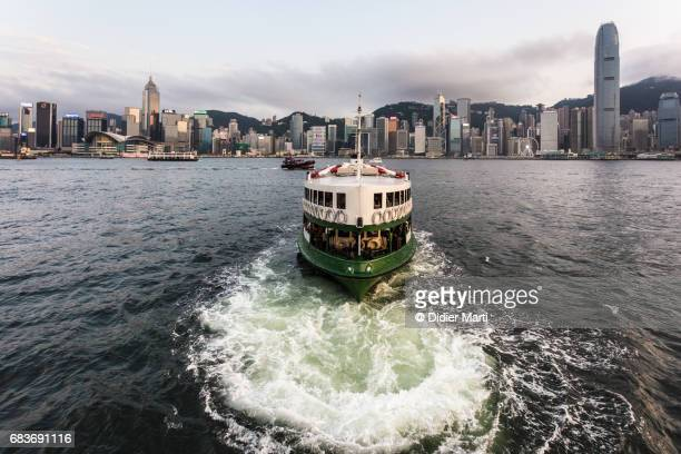 A star ferry boat reaching its terminal building in Tsim Sha Tsui in Kowloon, Hong Kong