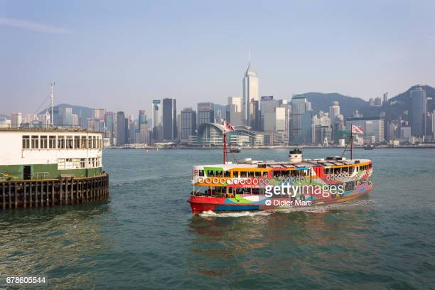A star ferry reaching the Tsim Sha Tsui pier in Kowloon, Hong Kong