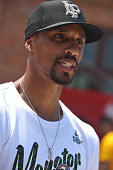 NBA star George Hill attends a charity activity with leftbehind children at a school on July 22 2016 in Fuyang Anhui Province of China