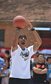 NBA star George Hill plays basketball as he attends a charity activity with leftbehind children at a school on July 22 2016 in Fuyang Anhui Province...