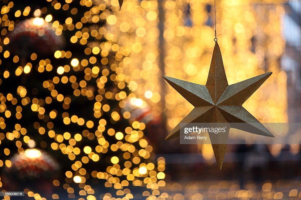 A star hangs near a Christmas tree during Christmas shopping season in a shopping mall on December 8, 2012 in Berlin, Germany. German consumer confidence dropped prior to the Christmas season from a high level, according to a survey released at the end of November, expecting to harm retail sales in December, but not to the point of hurting businesses greatly.