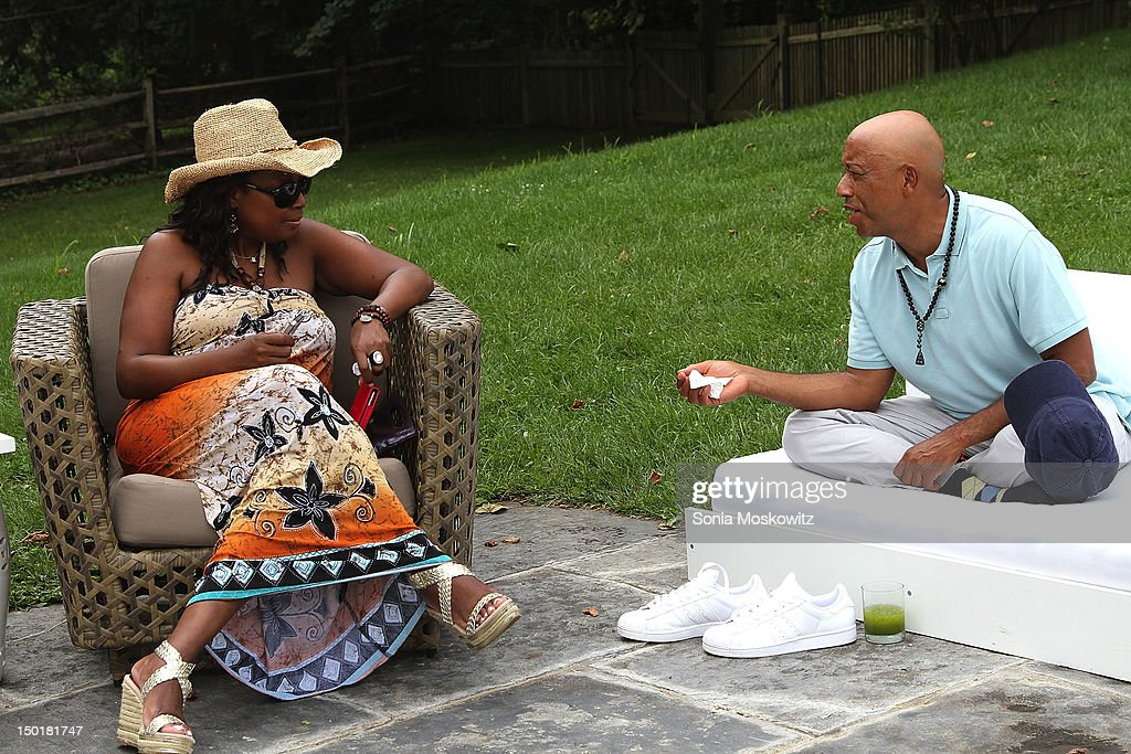 Star Jones and Russell Simmons attend the EleVen by Venus Williams party on August 11, 2012 in Southampton, New York.