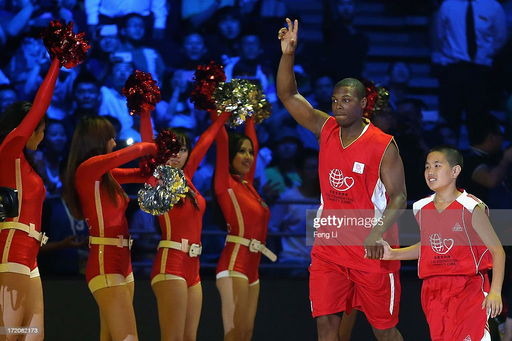 NBA star Kyle Lowry (2nd R) attends the 2013 Yao Foundation Charity Game between China and the NBA Stars on July 1, 2013 in Beijing, China.