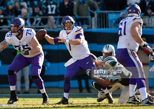 Star Lotulelei of the Carolina Panthers pressures Case Keenum of the Minnesota Vikings during their game at Bank of America Stadium on December 10...
